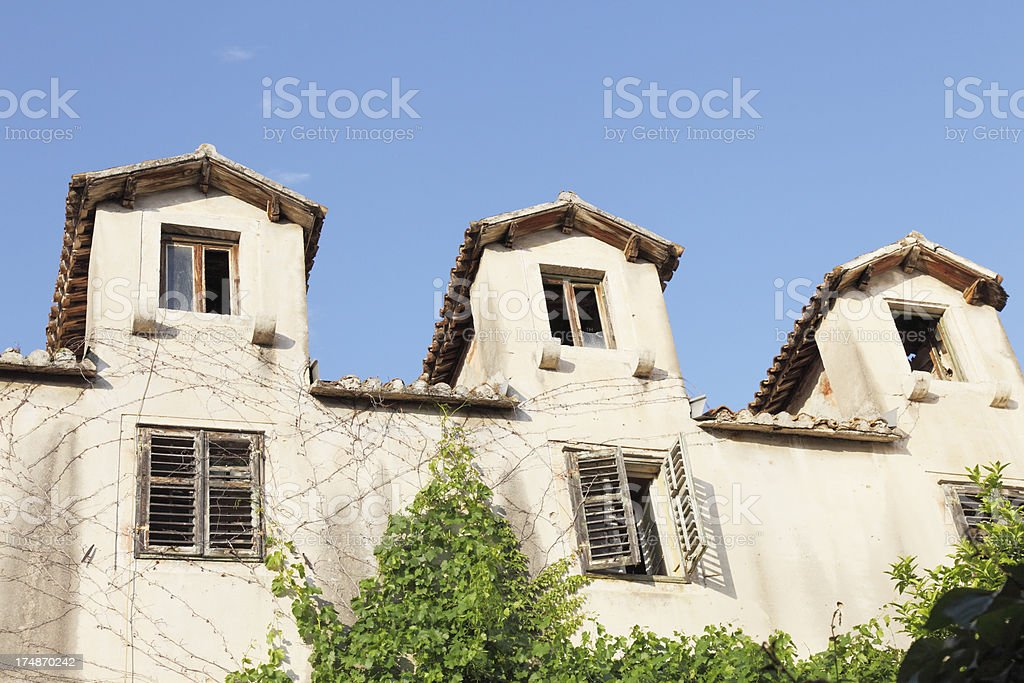 three weathered mediterranean historic facade  roofs in  Croatia royalty-free stock photo