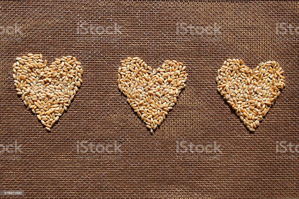 Three wheat grains hearts stock photo