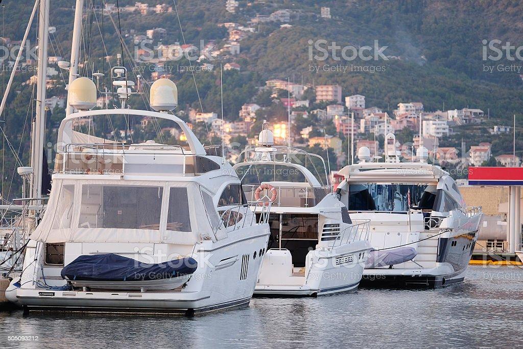 Three white boats on the berth stock photo