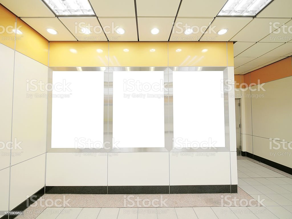 Three white lanes or blank billboards in a hallway royalty-free stock photo