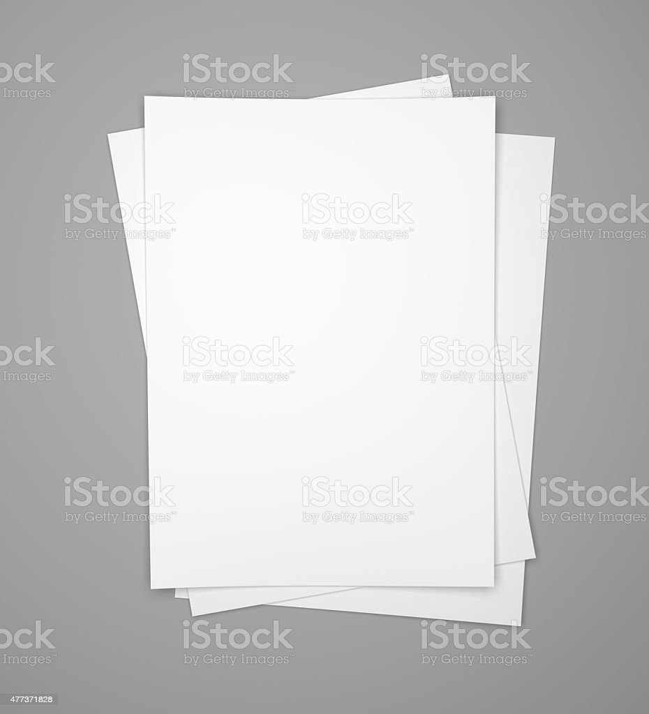 Three white paper sheets on gray stock photo