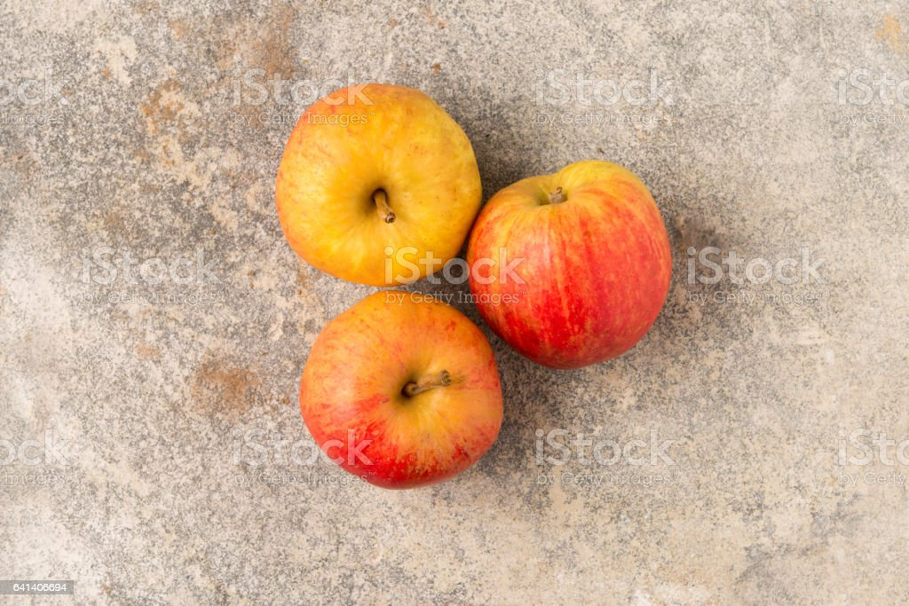 Three Whole Unpeeled Fresh Apples stock photo