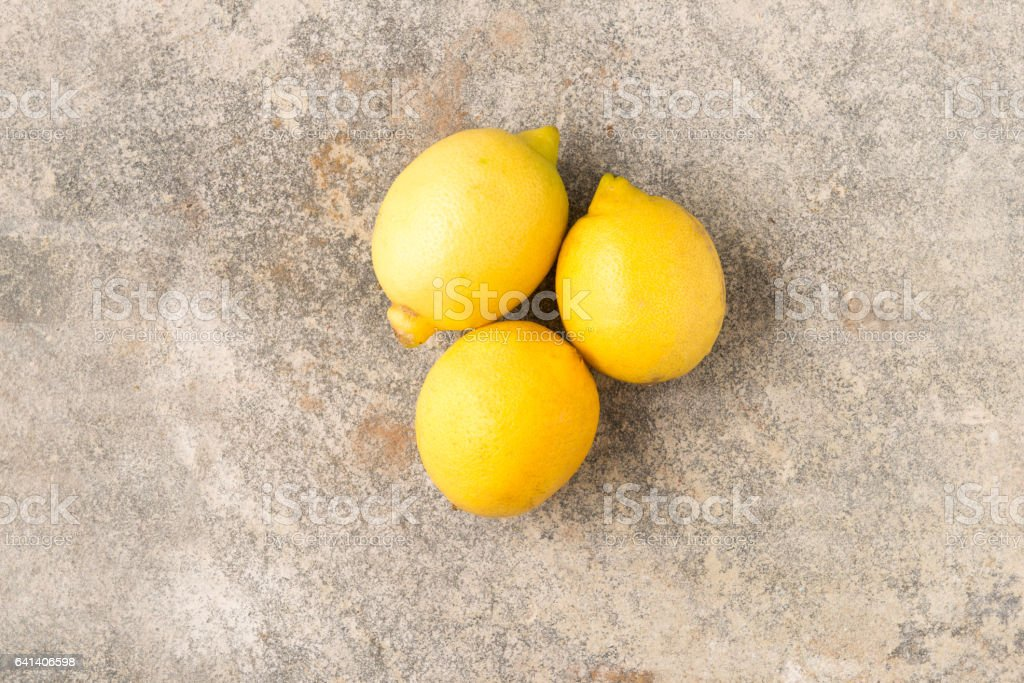 Three Whole Unpeeled Lemons stock photo