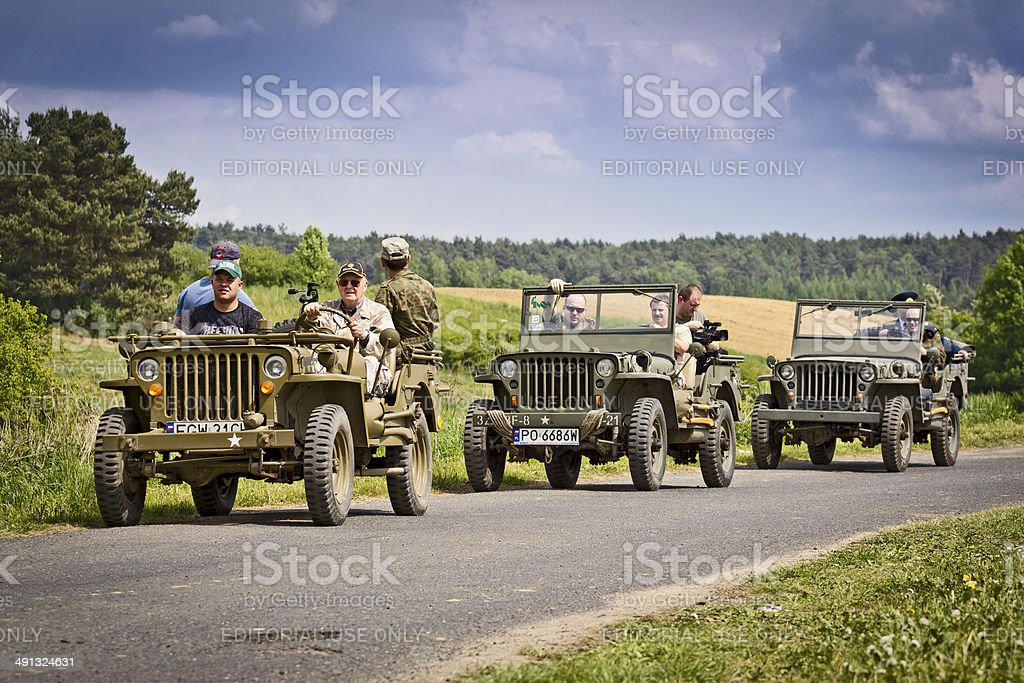 Three Willys Jeep on the road stock photo