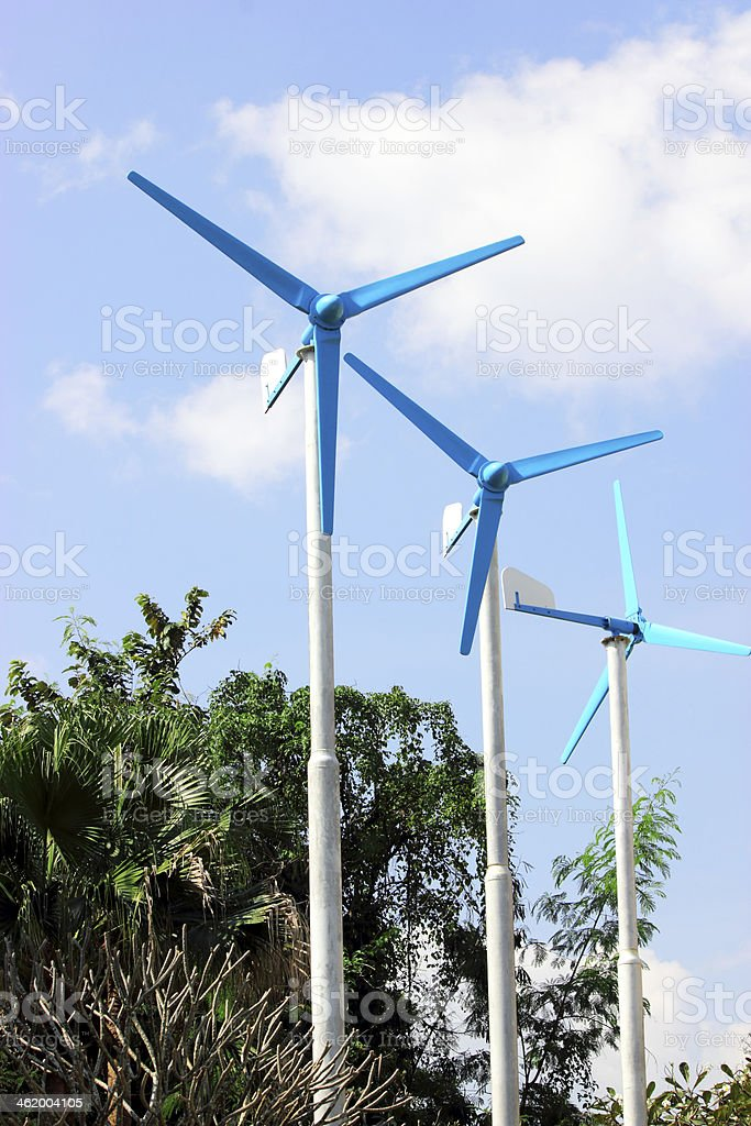 Three wind turbine generating electricity on blue sky royalty-free stock photo