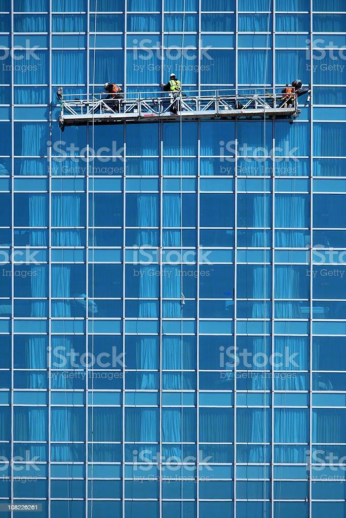 Three Window Washers royalty-free stock photo