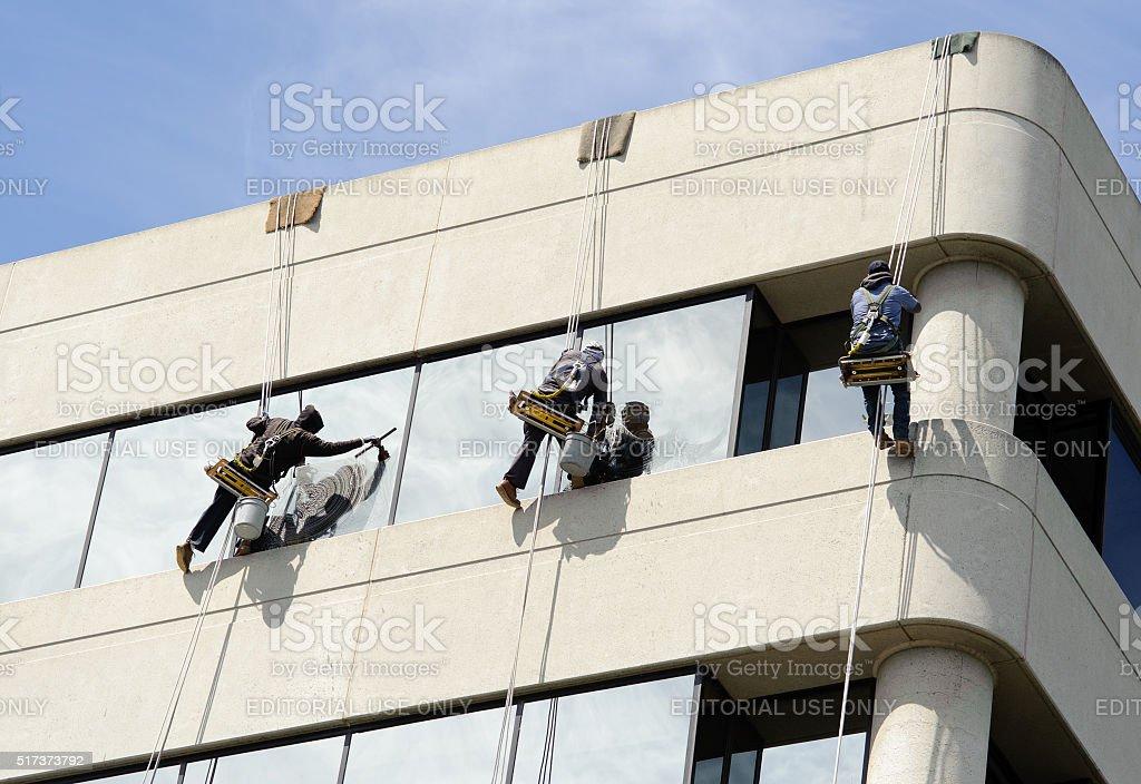 Three Window Washers Rappelling stock photo