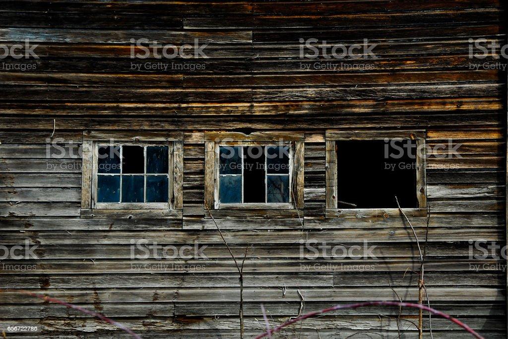 Three Windows  of Old Barn stock photo