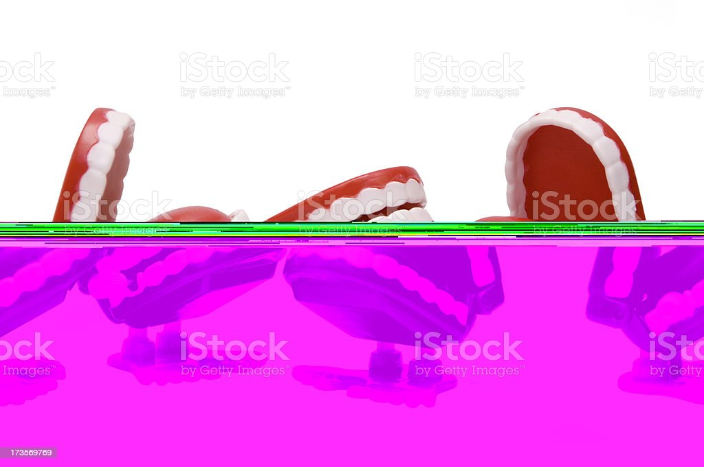 Three wind-up chattering teeth toys with feet stock photo