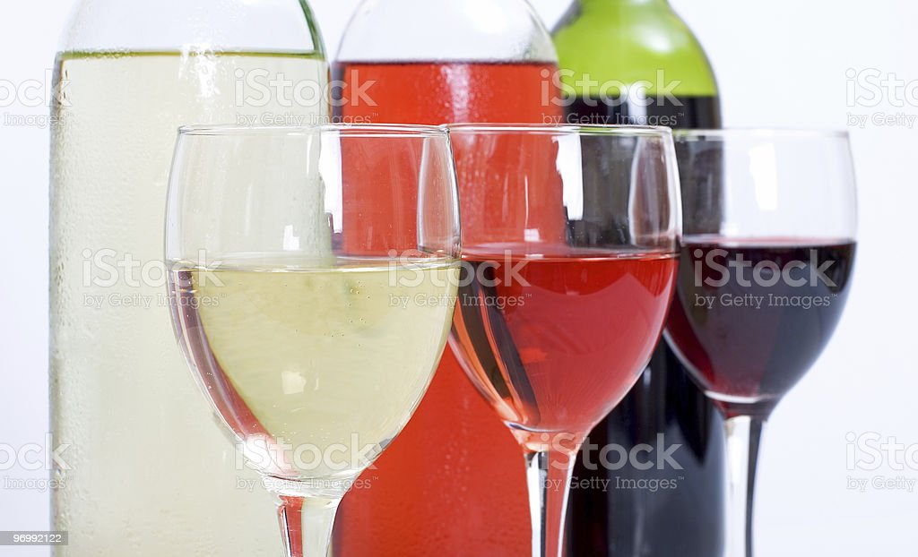 Three wine bottles and glasses royalty-free stock photo
