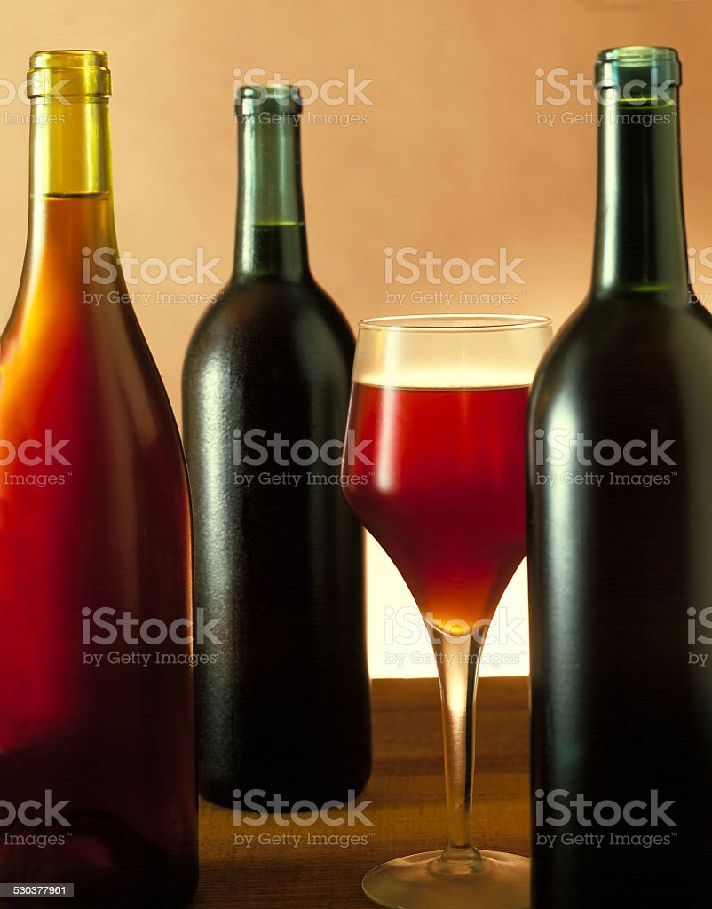 Three Wine bottles & Glass stock photo