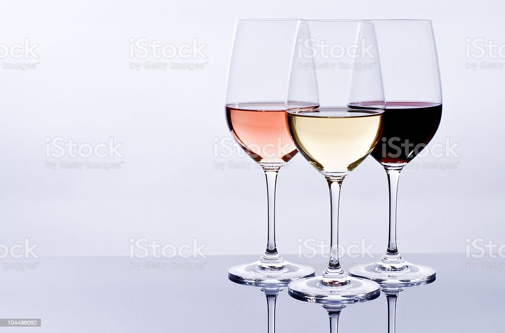 Three wine glasses filled with colorful wine stock photo