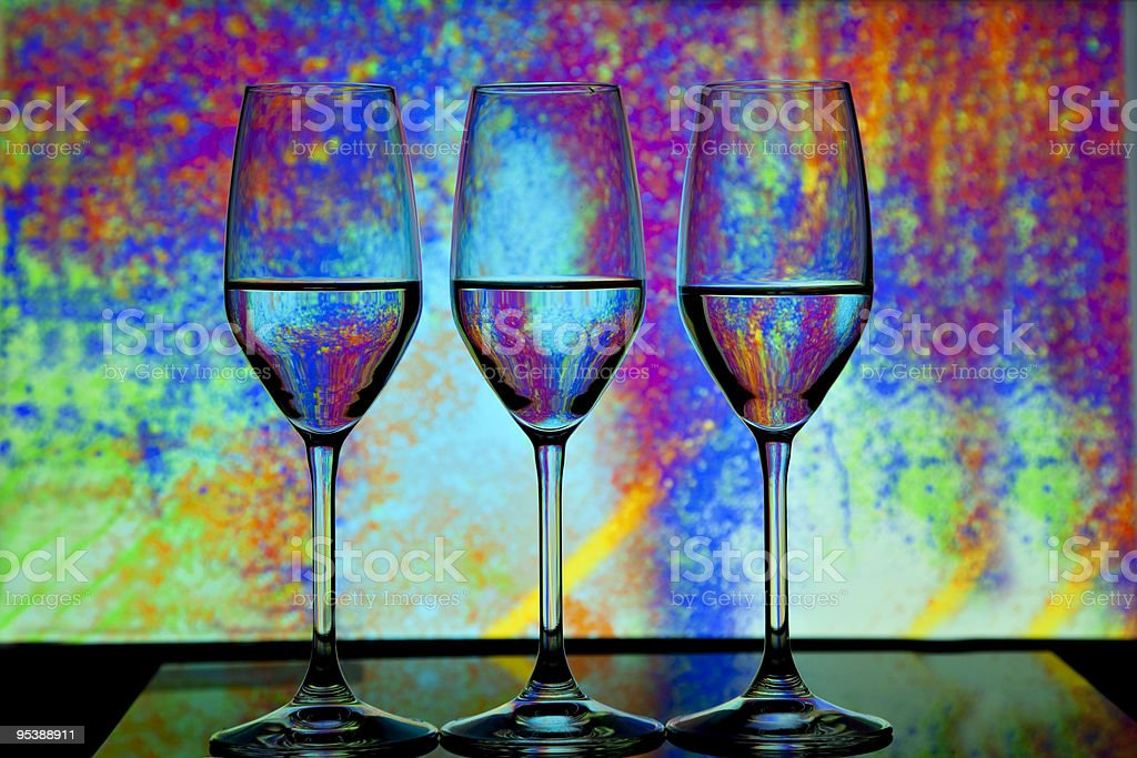 Three wine glasses in front of colorful background royalty-free stock photo