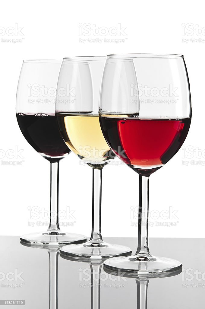Three wine glasses, white, red and rose isolated on white stock photo