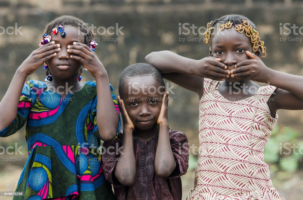 Three wise African children - Embody the proverb: 'see no evil, hear no evil, speak no evil' stock photo