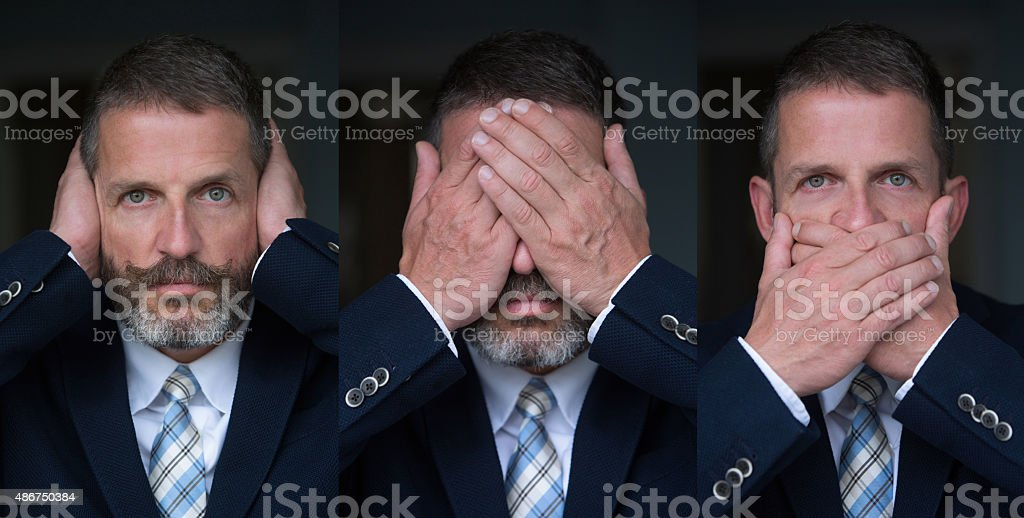 three wise monkeys- businessman stock photo