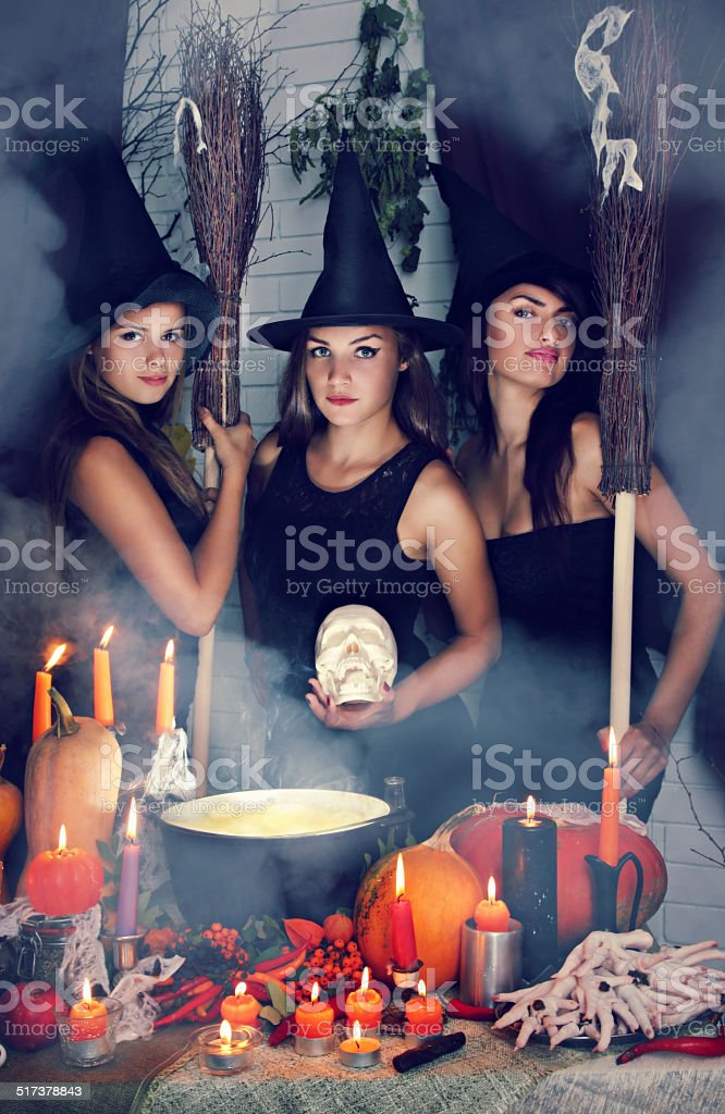 three witch with a skull.tinted stock photo