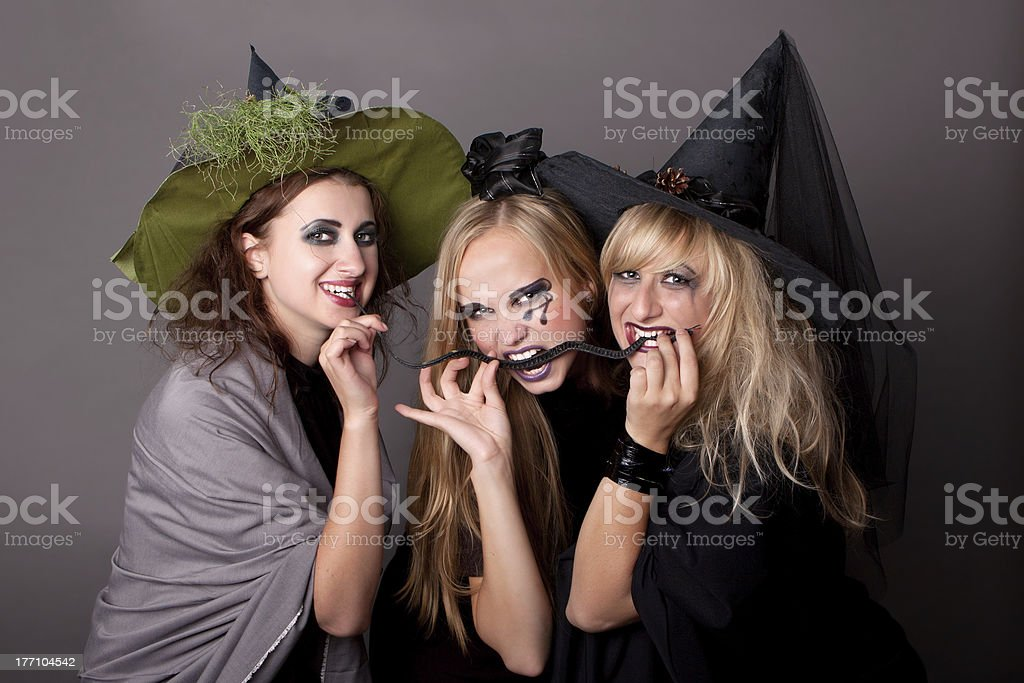 three witches eat  black snake royalty-free stock photo