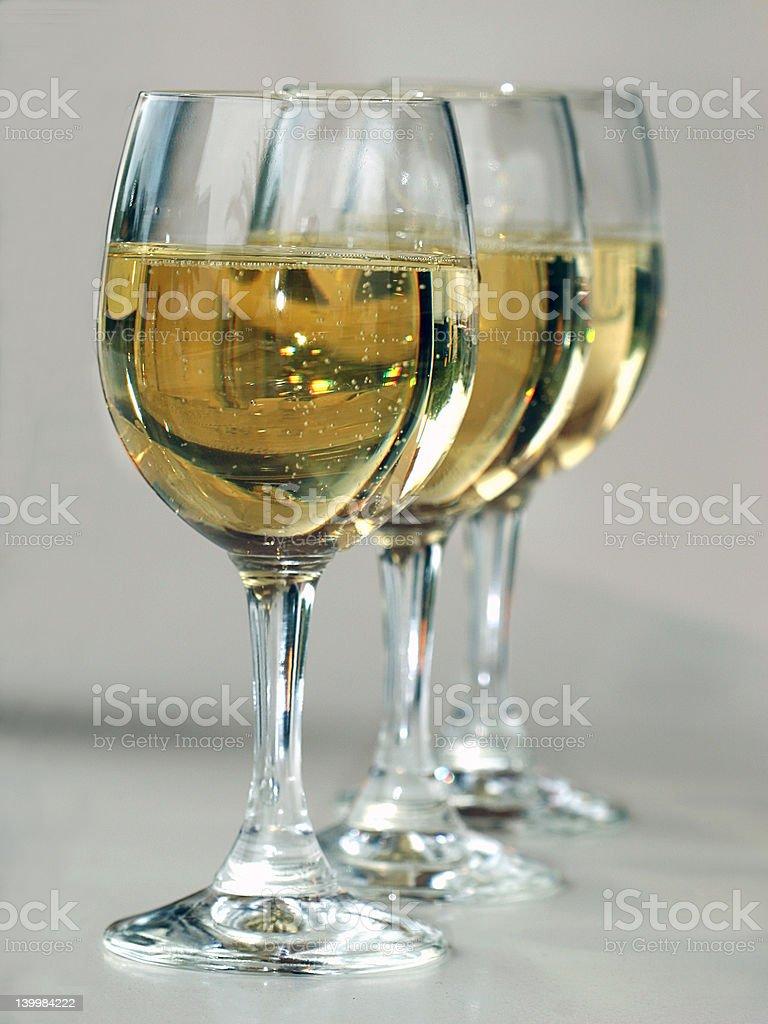 three with wine glasses stock photo
