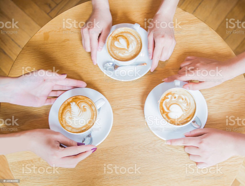 Three woman enjoying their cup of coffee stock photo