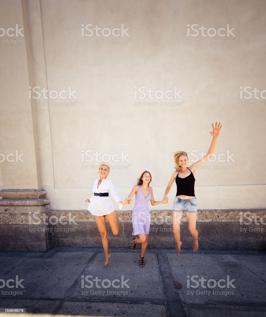 three woman jumping for fun - friends girl royalty-free stock photo