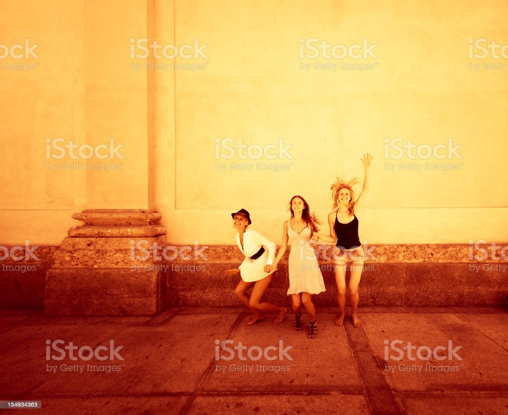 three woman jumping for fun - frinds girl royalty-free stock photo