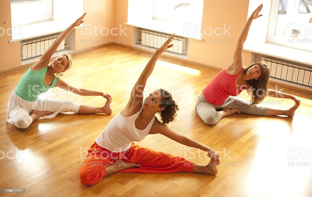 Three woman practicing yoga royalty-free stock photo