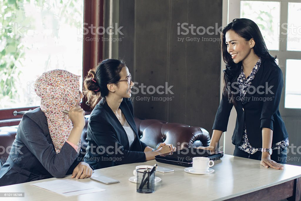 three woman talking at the office stock photo