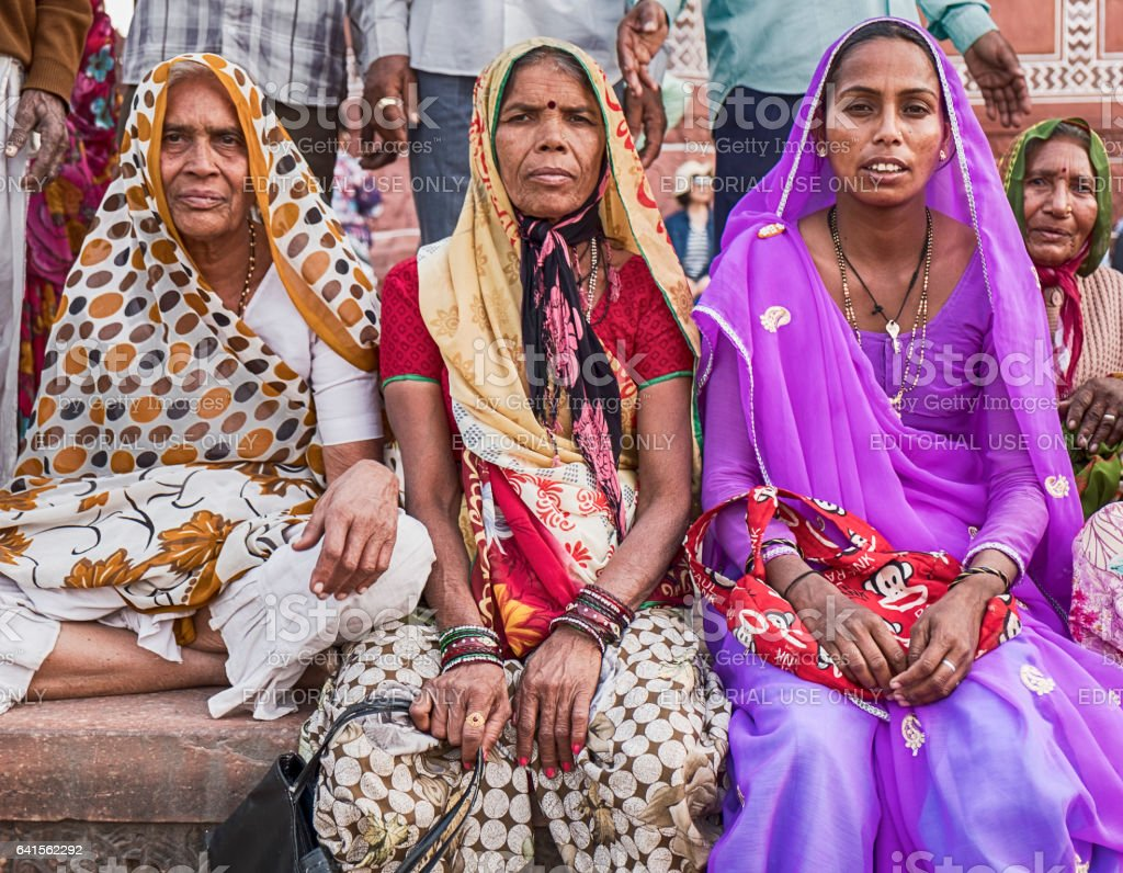 Three Women At The Taj Mahal stock photo