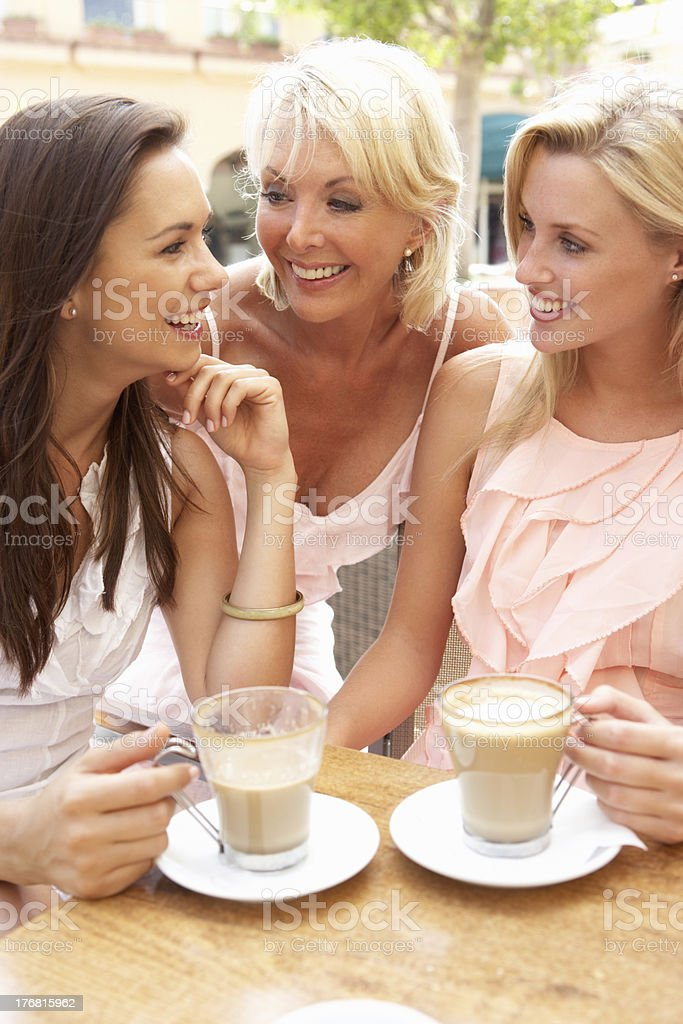 Three Women Enjoying Cup Of Coffee In Caf royalty-free stock photo