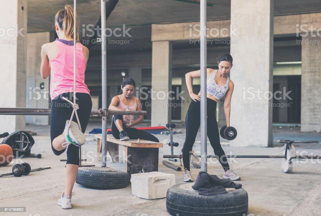 Three women exercising in an urban gym stock photo