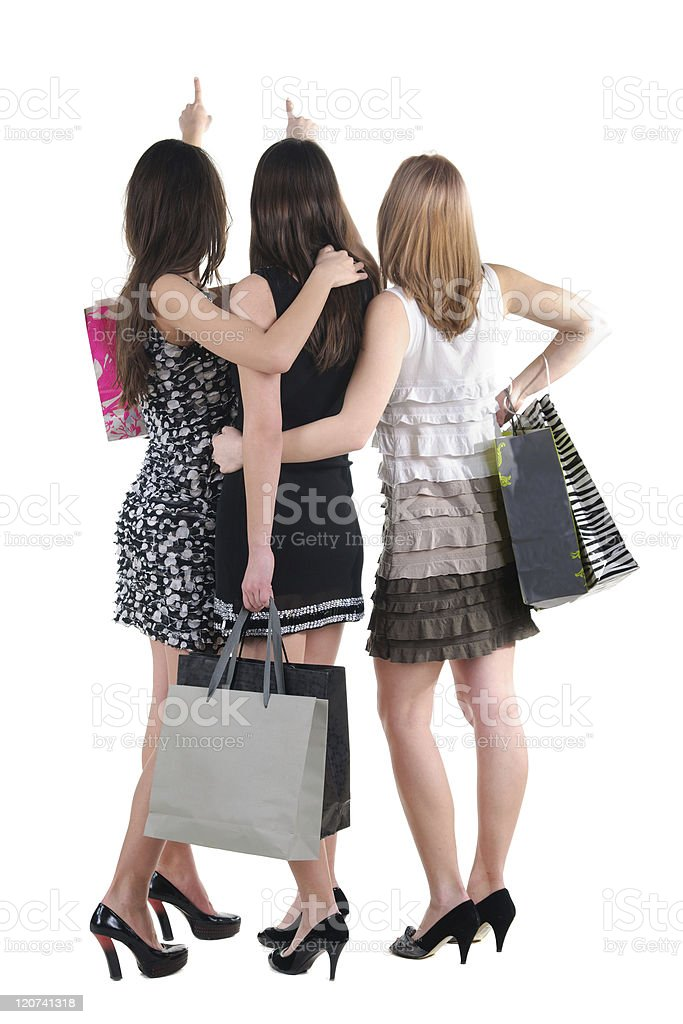 Three women from behind with shopping bags royalty-free stock photo