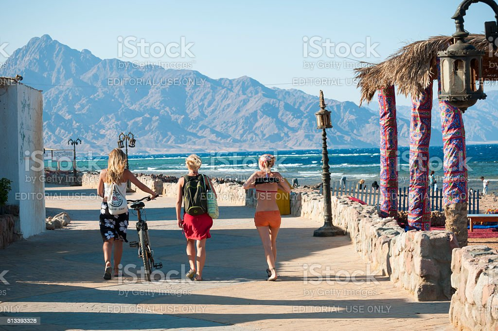 Three women in Dahab, Sinai, Egypt stock photo
