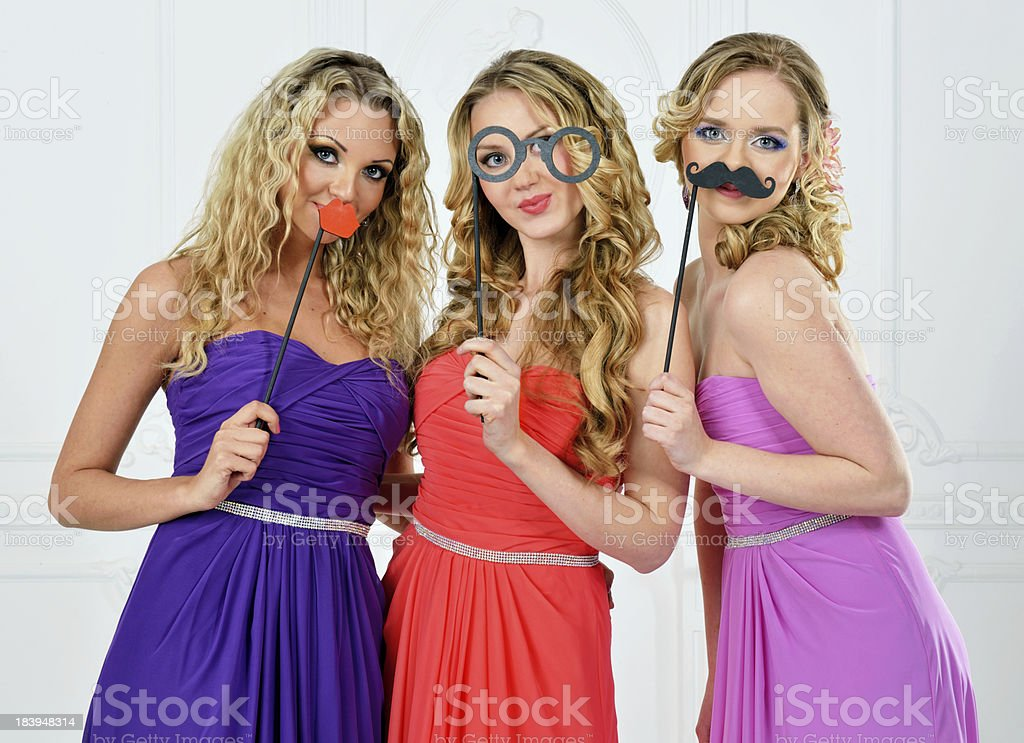 Three women in evening gown with masks. royalty-free stock photo