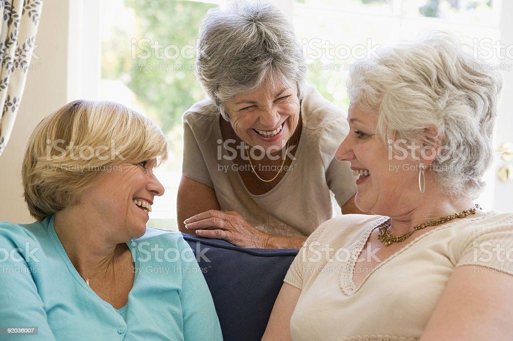 Three women in living room talking royalty-free stock photo