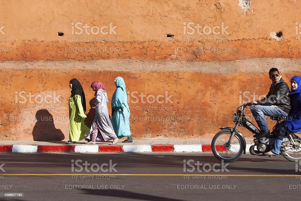 Three women in Marrakech against the Medina Wall royalty-free stock photo