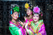 Three women in old traditional chinese dresses