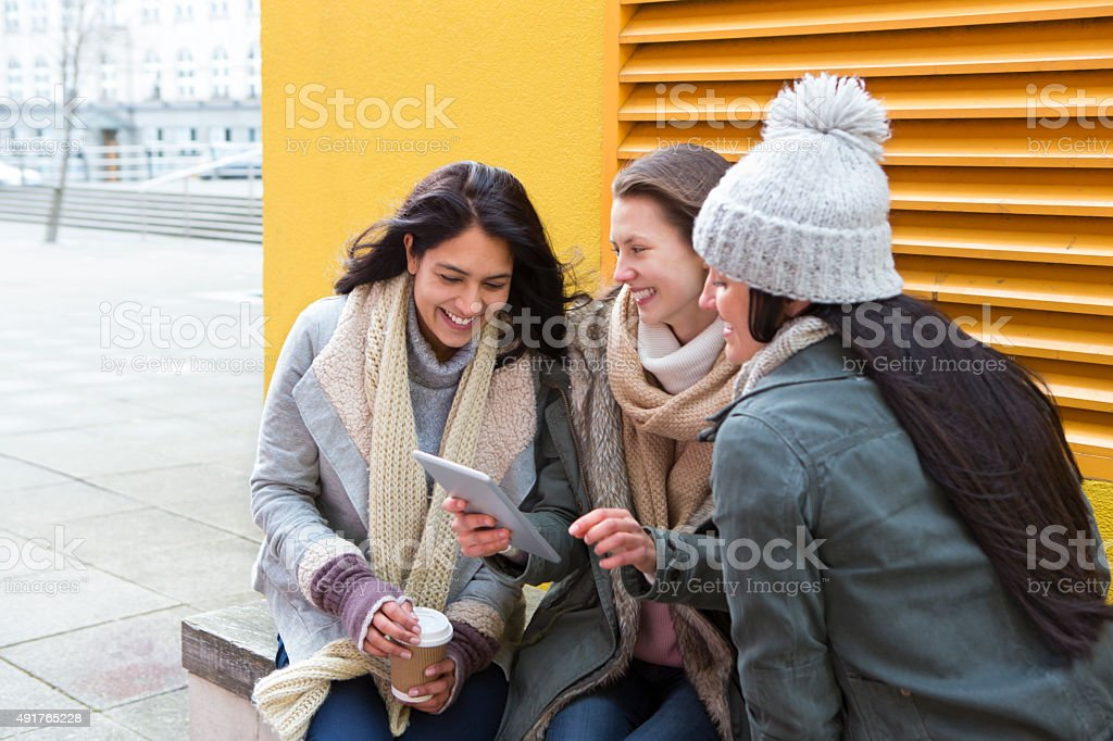 Three women in the city stock photo