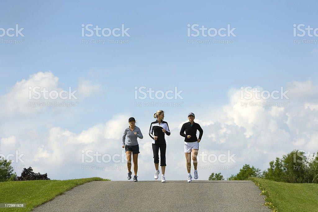 Three Women Jogging royalty-free stock photo
