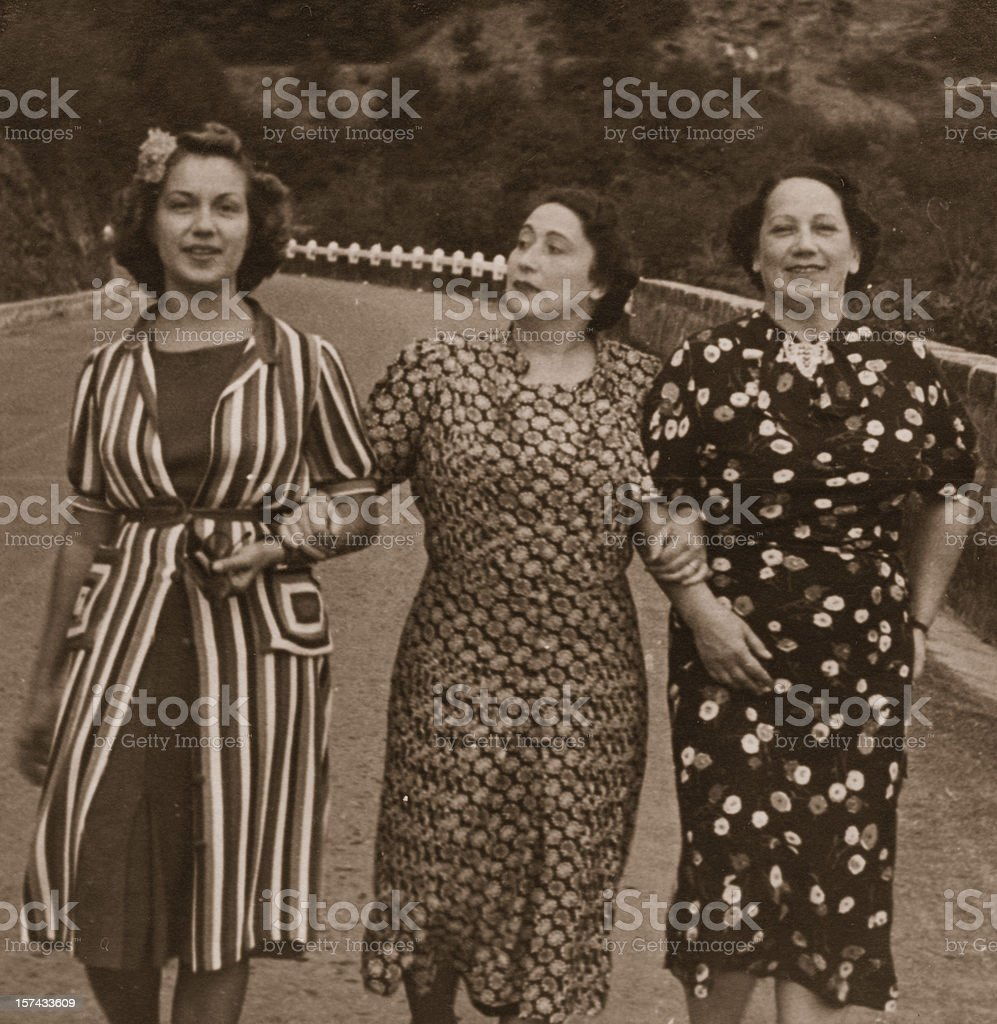 Three Women on the Road in 1931.Sepia Toned stock photo