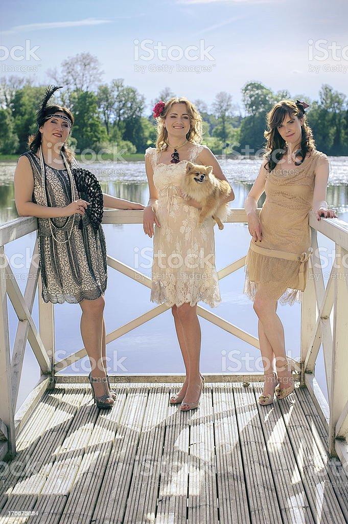 Three women partying retro style royalty-free stock photo