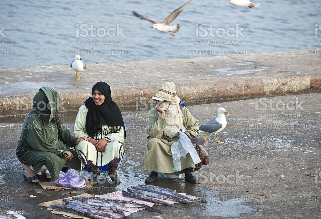 Three Women Selling Fish in Essaouira Morocco Africa royalty-free stock photo