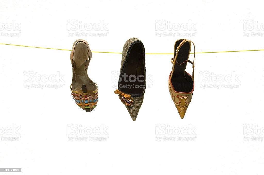 Three women summer shoe on the clothesline white background stock photo