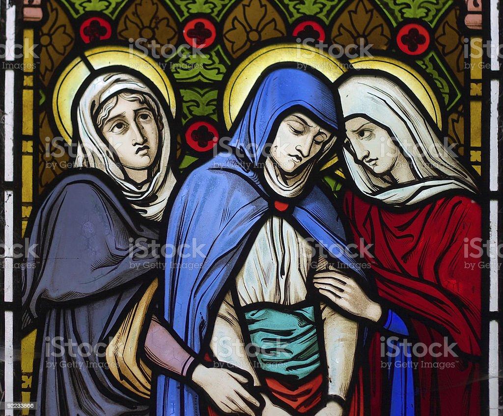 Three women under the cross stock photo