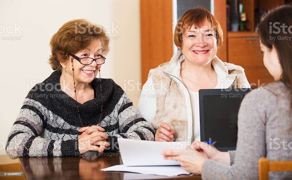 Three women with papers stock photo