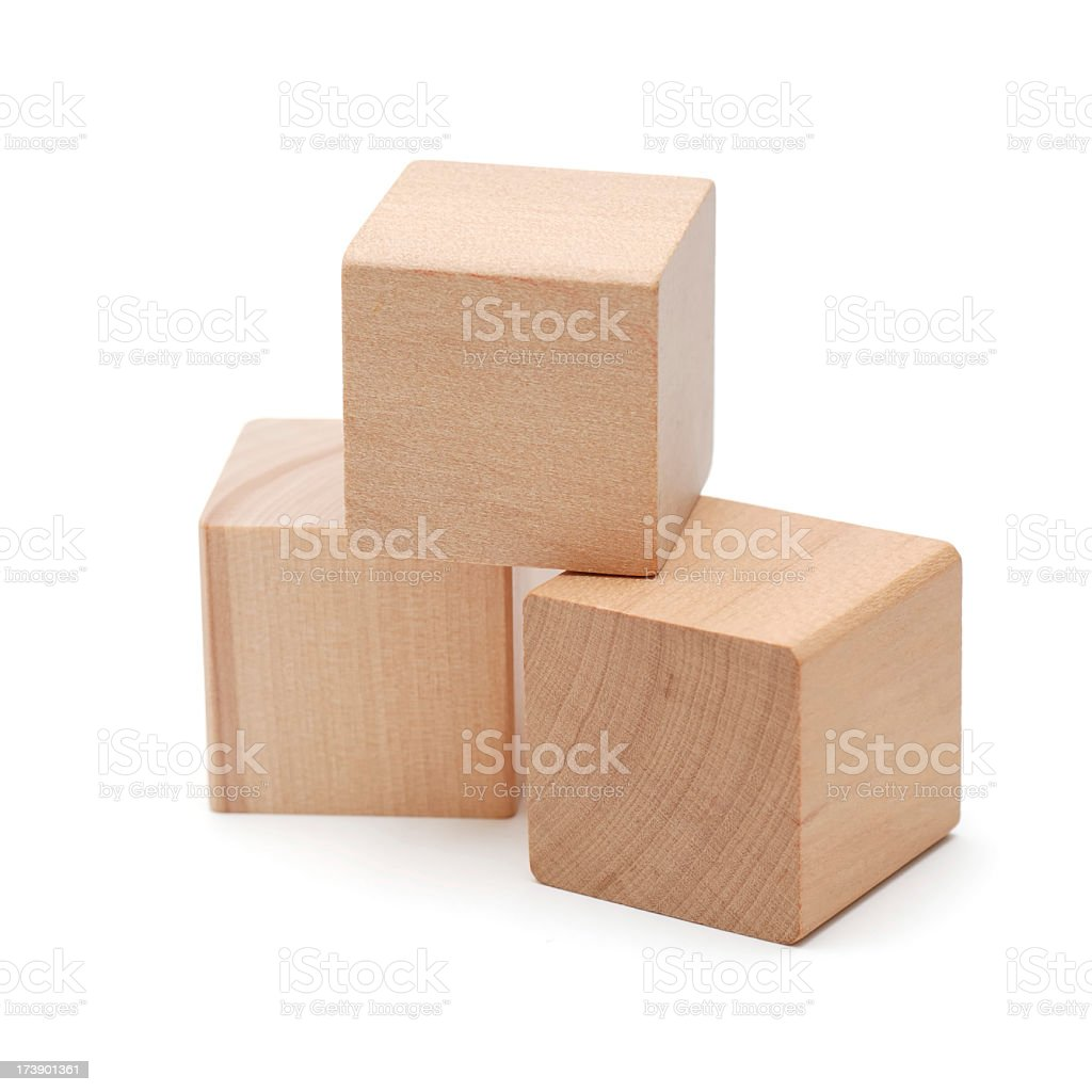 Three wooden block cubes stacked on each other stock photo