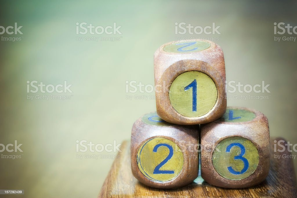 Three wooden dice with blue numbers stock photo
