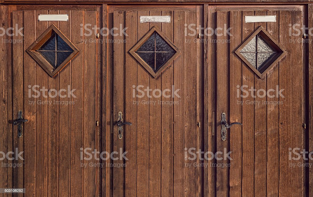three wooden doors stock photo