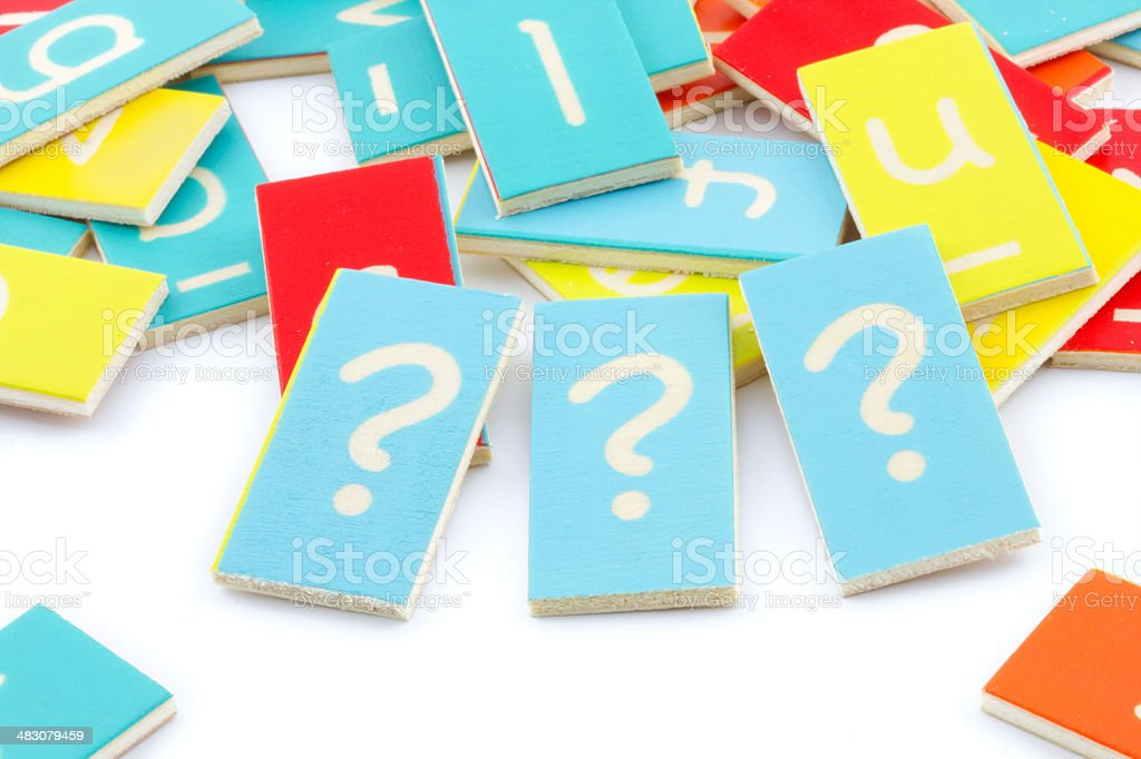 three wooden question marks stock photo