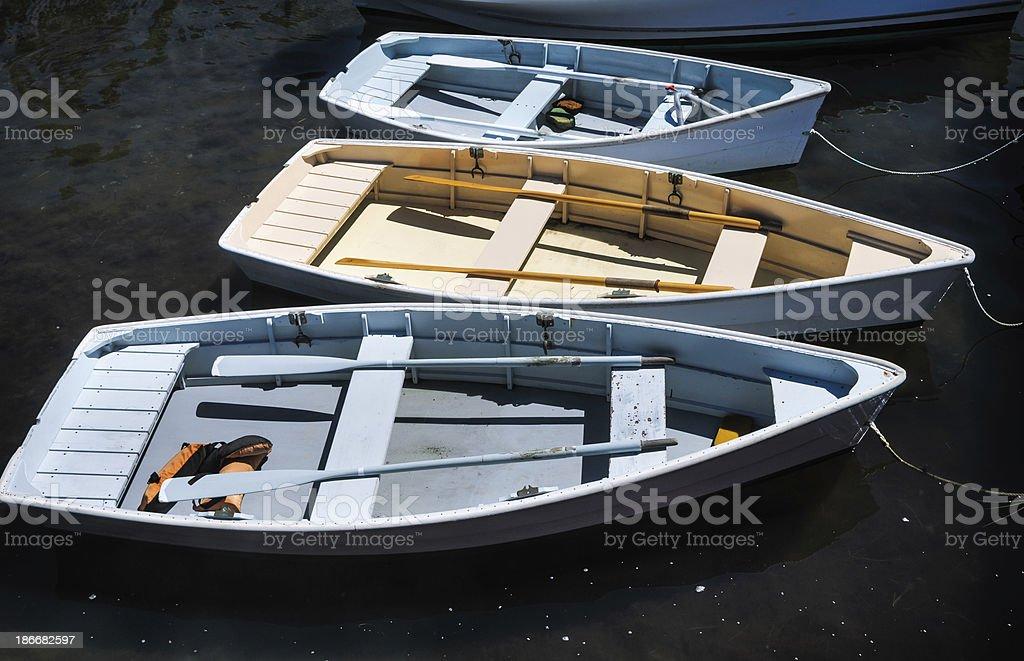 Three Wooden Rowboats royalty-free stock photo